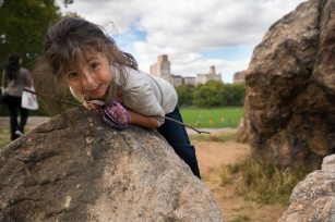 Elise Climbing Rocks in Central Park NYC