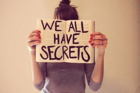 girl with book that reads we all have secrets